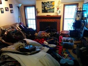 This is what it looks like when you have to empty your entire closet into your living room so that your landlord can try an find the source of the fucking water pouring from the fucking ceiling onto your fucking bed.